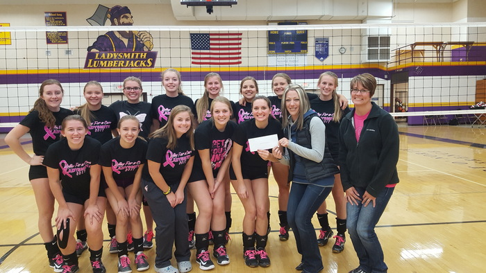 LHS Volleyball Team presenting a check to the WWCF.